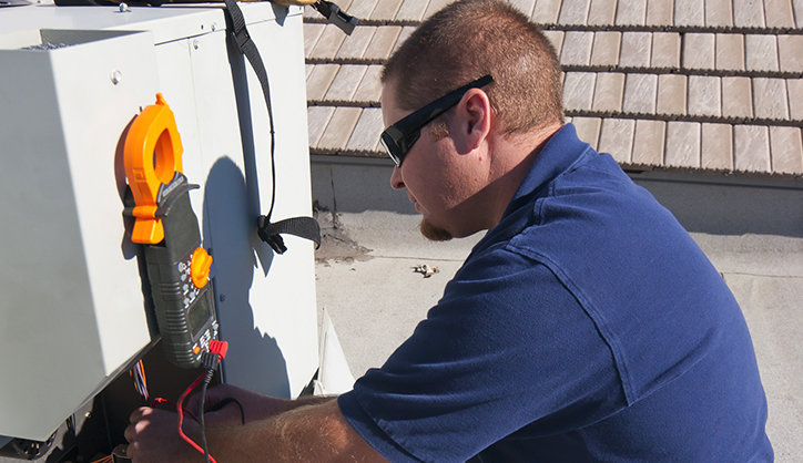 man working on air conditioner